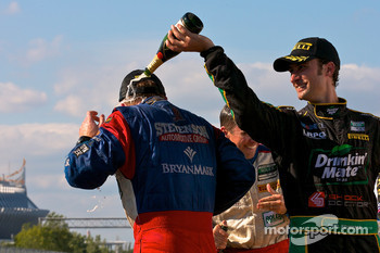 GT podium: class winner Paul Edwards celebrates with champagne