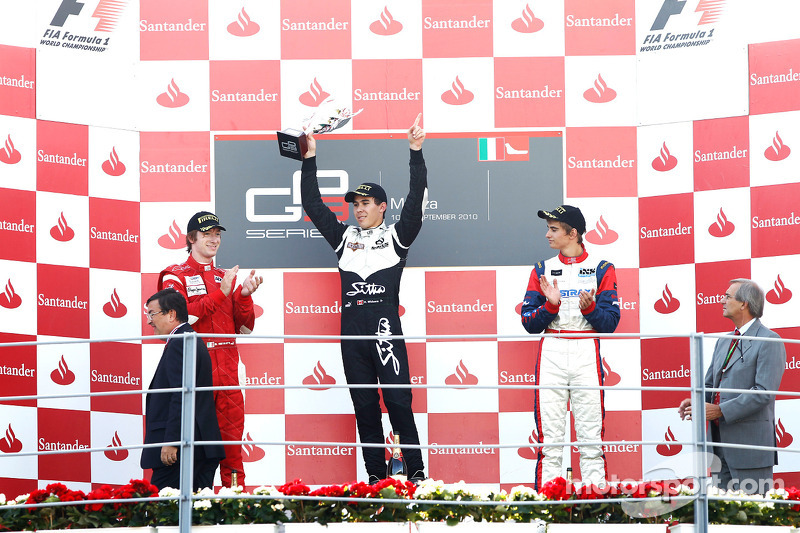 Robert Wickens celebrates victory on the podium with Nico Muller and Mirko Bortolotti