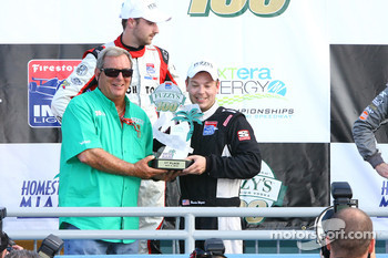 Fuzzy Zoeller presents Brandon Wagner with the first place trophy