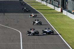 Michael Schumacher, Mercedes GP and Rubens Barrichello, Williams F1 Team