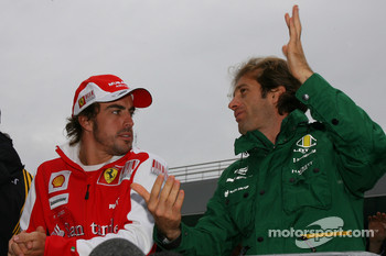 Fernando Alonso, Scuderia Ferrari and Jarno Trulli, Lotus F1 Team