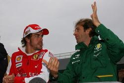 Fernando Alonso, Scuderia Ferrari and Jarno Trulli, Lotus F1 Team
