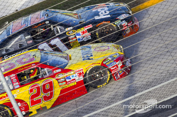 Denny Hamlin, Joe Gibbs Racing Toyota passes Kevin Harvick, Richard Childress Racing Chevrolet