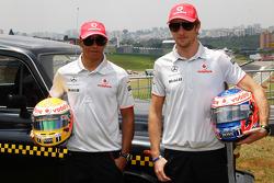 Lewis Hamilton, McLaren Mercedes, Jenson Button, McLaren Mercedes with a London taxi