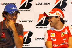 Bruno Senna, Hispania Racing F1 Team and Felipe Massa, Scuderia Ferrari during the Bridgestone conference