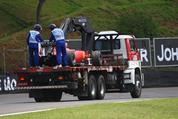 Fernando Alonso, Scuderia Ferrari car is taken back to the pits