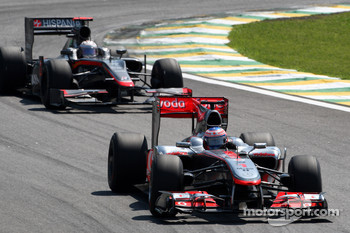 Jenson Button, McLaren Mercedes leads Christian Klien, test driver, Hispania Racing F1 Team