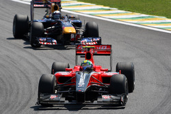 Lucas di Grassi, Virgin Racing leads Sebastian Vettel, Red Bull Racing