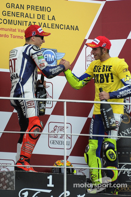Podium: race winner Jorge Lorenzo, Fiat Yamaha Team, third place Valentino Rossi, Fiat Yamaha Team