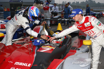 Race winner Stéphane Sarrazin celebrates with Tom Kristensen and Allan McNish
