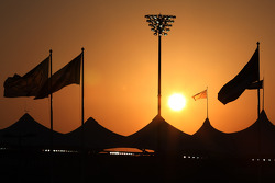 The sun sets behind the grandstands