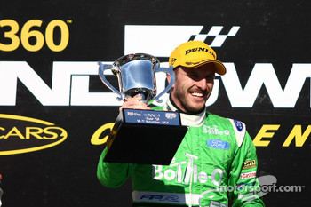 Paul Dumbrell celebrates his first career victory