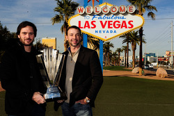 Five-time NASCAR Sprint Cup Series Champion Jimmie Johnson and crew chief Chad Knaus pose with the 2010 trophy