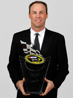 NASCAR driver Kevin Harvick poses with his third place trophy