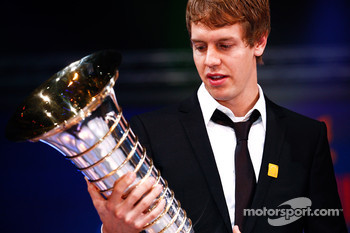 FIA Formula One World Champion Sebastian Vettel with the Drivers' trophy