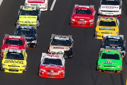 Reed Sorenson, Turner Motorsport Chevrolet, Todd Bodine, Germain Racing Toyota and Danica Patrick, JR Motorsport Chevrolet go three-wide
