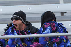 Fans bundle under a blanket while watching the Kragen Oreilly Auto Parts NHRA Winternationals