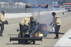 NHRA Safety Safari attending to a header fire on Troy Buff's BME / Okuma Top Fuel Dragster