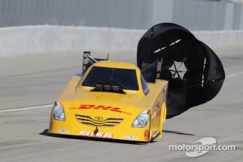 Jeff Arend deploys the parachutes on his DHL Toyota Camry
