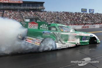 John Force doing a burnout in his Castrol GTX High Mileage Ford Mustang Funny Car