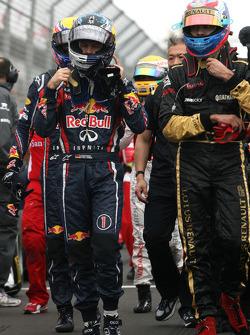 Sebastian Vettel, Red Bull Racing and Vitaly Petrov, Lotus Renault GP