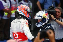 Race winner Sebastian Vettel, Red Bull Racing with second place Jenson Button, McLaren Mercedes