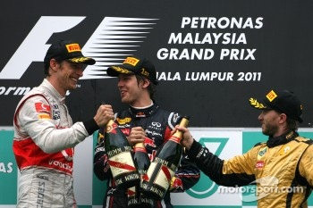 Podium: race winner Sebastian Vettel, Red Bull Racing, second place Jenson Button, McLaren Mercedes, third place Nick Heidfeld, Lotus Renault F1 Team