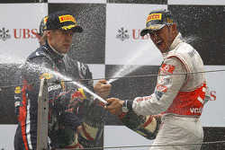 Podium: race winner Lewis Hamilton, McLaren Mercedes, with second place Sebastian Vettel, Red Bull Racing