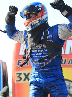 Jack Beckman emerges from his Funny Car triumphantly after winning