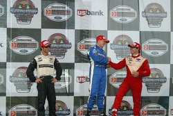 A.J. Allmendinger is congratulated by Oriol Servia