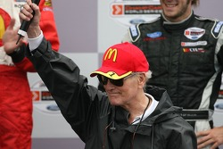 Podium: Paul Newman speaks to the fans