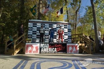 Podium: A.J. Allmendinger, Sbastien Bourdais and Bruno Junqueira