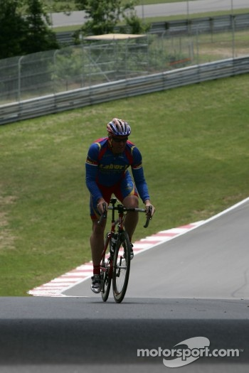 Paul Tracy rides his bike up the steep Mont-Tremblant track hill