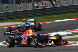 Sebastian Vettel, Red Bull Racing leads Nico Rosberg, Mercedes GP F1 Team