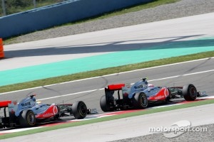 Jenson Button, McLaren Mercedes, MP4-26 leads Lewis Hamilton, McLaren Mercedes, MP4-26