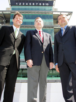 Todd Harris, left, Brent Musburger, center, and Gil de Ferran in the shadow of the Bombardier Pagoda at Indianapolis