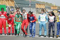 Tony Kanaan, Dan Wheldon and Dario Franchitti have fun at the photoshoot