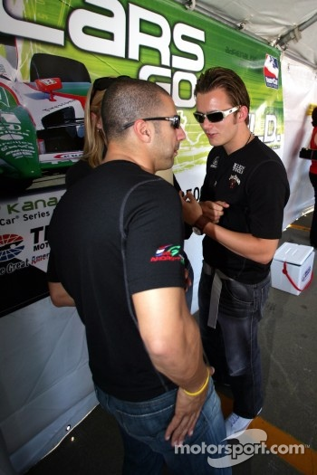 Autograph session: Tony Kanaan and Dan Wheldon