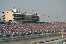 Crowd in the grandstand watch the race