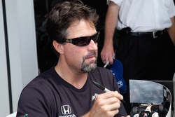 Michael Andretti signs a car for a fan
