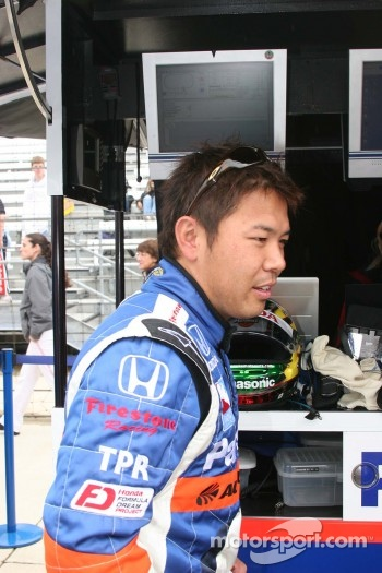 Kosuke Matsuura finds a dry spot in the rain