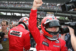 Helio Castroneves celebrates winning the Checkers/Rally's Pitstop Competition