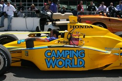 The car of John Andretti is brought to pitlane