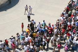 Tony Kanaan and Tomas Scheckter sign autographs