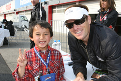 Scott Sharp and a young fan