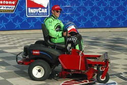 Scott Sharp receives a new Tora mower for winning the pole
