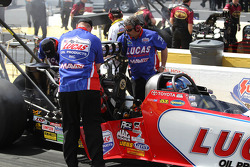 Crew members making adjustments to Lucas Oil Top Fuel dragster , driven by Morgan Lucas