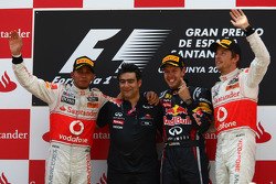 Podium: race winner Sebastian Vettel, Red Bull Racing, second place, Lewis Hamilton, McLaren Mercedes, third place Jenson Button, McLaren Mercedes