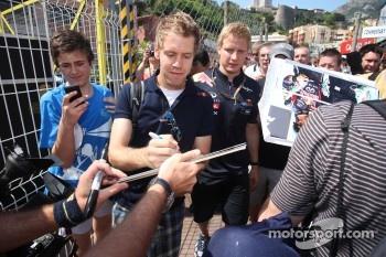 Sebastian Vettel, Red Bull Racing signing autographs for the fans