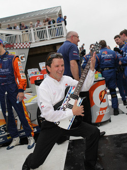 Victory lane: Wayne Taylor poses with his PRS guitar